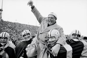 UNITED STATES - DECEMBER 31: Football: NFL championship, Green Bay Packers coach Vince Lombardi victorious, getting carried off field by team after winning game vs New York Giants, Green Bay, WI 12/31/1961 (Photo by Marvin E. Newman/Sports Illustrated/Getty Images) (SetNumber: X8174)