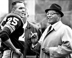 Packers halfback Tom Moore with Coach Lombardi after Moore's 77 yard touchdown run against the Detroit Lions in 1963. ------ Journal Sentinel archives